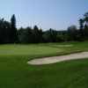 A view of a green protected by sand traps at Michipicoten Golf Club