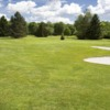 View of a green and bunker at Tara Greens Golf Center