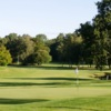 A sunny day view of a hole at Delsjo Golf Club.