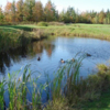 A view over a pond at Le Deauville from Club de Golf Venise.