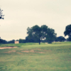 A view of a green at Devine Golf Course.