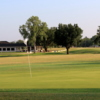 A view of a green and the clubhouse in background at Gatesville Country Club.