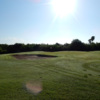 A sunny day view of a green at Tony Butler Golf Course.