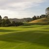 A sunny day view from Wainui Golf Club with the clubhouse in the distance.