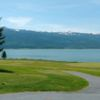 A view of a tee and a green with water in background at Cascade Golf Course.