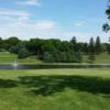 A view of the practice putting green and a hole in the distance at Round Grove Golf & Country Club.