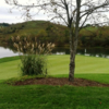 A view of a green surrounded by water at Glenrochie Country Club.
