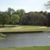 A view of a green with water and bunkers coming into play at Tuscarora Country Club.