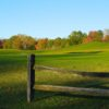 A fall day view of a hole at Chatmoss Country Club.