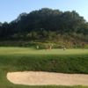 A sunny day view of a hole from The Course At Yale.