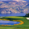 A view of a green surrounded by water at Bear Mountain Ranch.