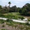 """A view of a green at Town Park Villas Golf Course (""""Kang"""" (Yuan Kang) Lee)."""