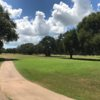 A sunny day view of tee #8 at Bay-Cel Golf Course.