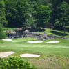 A sunny day view of a fairway at Great River Golf Club.