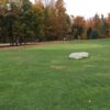 A fall day view of a green at Woodbury Golf Course.