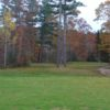 A fall day view of a hole at Streamside Golf Course.