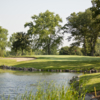 A view of a hole protected by a pond at Tuckaway Country Club.