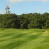 A sunny day view from a fairway at Caddington Golf Club.