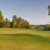 A sunny day view of a hole at Providence Club.