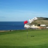 A sunny day view of a green with water in background at Freshwater Bay Golf Club.