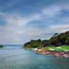 A view of green #9 surrounded by water and sand traps at Ocean Course from Ria Bintan Golf Club.