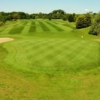 A view of a hole flanked by bunkers at Cambridge Meridian Golf Club.