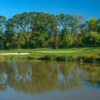 A sunset view of a green with water coming into play at Knob Hill Golf Club.