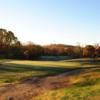 A sunny day view of a green at Rock Creek Golf Course.