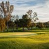 A sunny day view of a hole at Oaks North Golf Course.