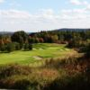 A fall day view of a well protected green at Greystone Golf Club.