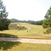 A sunny day view of a green at Mallard Pointe Golf Course.