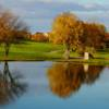 A fall day view of a fairway at Four Bridges Country Club.