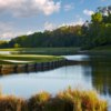 A view of a green surrounded by water at Woodside Plantation Country Club.