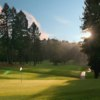 A sunny view of a hole at Tilden Park Golf Course.