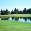A view over the water of a green at Sand Creek Golf Course.