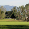 A sunny day view of a green at Whittier Narrows Golf Course.