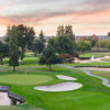 A view of a green protected by bunkers and a pond at San Joaquin Country Club.