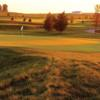 A sunset view of a green at Somerby Golf Club.
