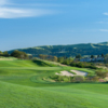 A sunny day view of a hole at The Bridges Golf Club.