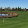 A sunny day view of a hole at Rooster Run Golf Club.