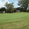 A sunny day view of a green at Northdale Golf Club.