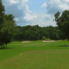 A sunny day view from a tee at River Ridge Golf Club.
