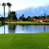 A view over the water of the 2nd green at Mission Lakes Country Club