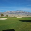 A sunny day view of a hole at Sandia Golf Club.