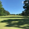 A sunny day view of a green at Twin Valley Country Club.