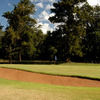 A view of green with bunker in foreground at Bulawayo Golf Club