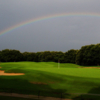 A view of a green flanked by bunkers at Trophy Club Country Club.