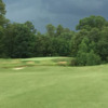 A cloudy day view of a hole at Heatherwood Hills Country Club.