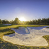 A view of a green protected by bunkers at Cypress Lakes Resort