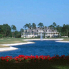 A view from the back of the lake with the 18th hole on the left, the 9th on the right and clubhouse in background at Jacksonville Golf & Country Club